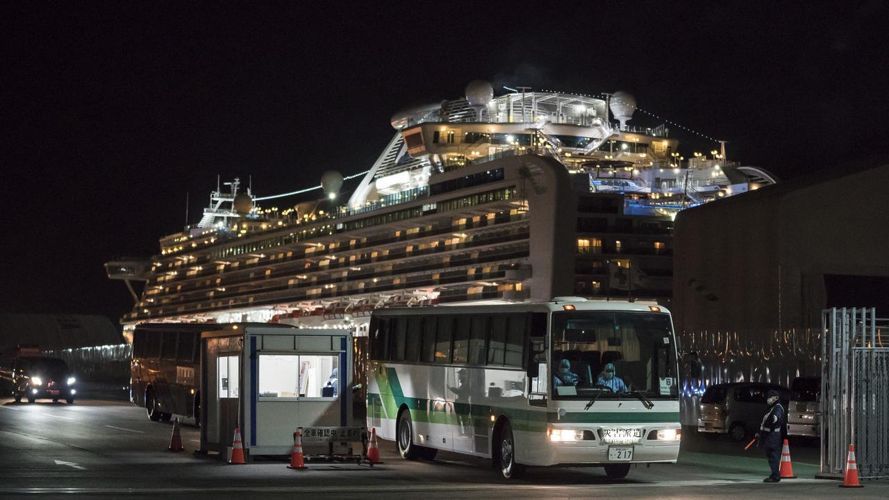 A bus carrying passengers out of the quarantined Diamond Princess cruise ship. Picture: Tomohiro Ohsumi/Getty Images