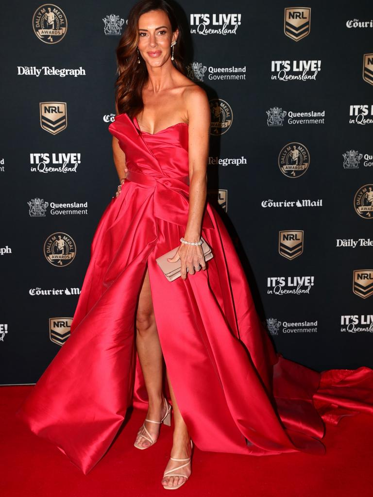 Kelly Turner, wife of Rabbitohs player Dane Gagai, also went for a bold red dress. Picture: Chris Hyde/Getty Images