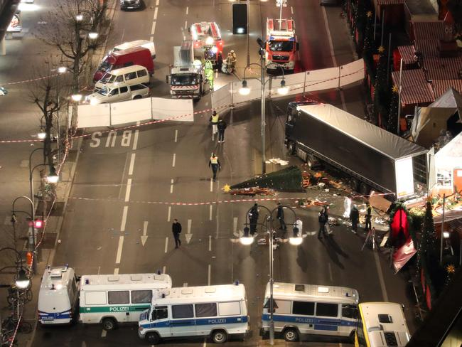 Christmas trees were scattered and bodies left lying on the road in the deadly attack. Picture: Michael Kappeler/dpa via AP