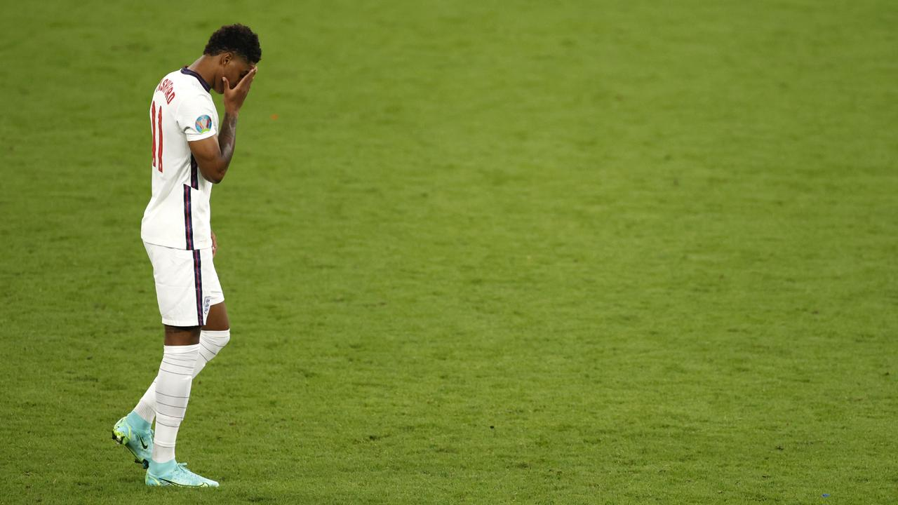 LONDON, ENGLAND - JULY 11: Marcus Rashford of England reacts after missing their team's third penalty in the penalty shoot out during the UEFA Euro 2020 Championship Final between Italy and England at Wembley Stadium on July 11, 2021 in London, England. (Photo by John Sibley - Pool/Getty Images)
