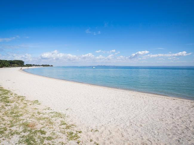 PORTARLINGTON The gentle waters of Port Phillip Bay make this spot perfect for family getaways. Portarlington, which rubs shoulders with Indented Head next door, has barbecues and picnic areas, a pier, and a large camping area. If you want a change of scenery from paddling in the clear water, head to a wine tasting at some of the surrounding vineyards. Picture: Visit Victoria