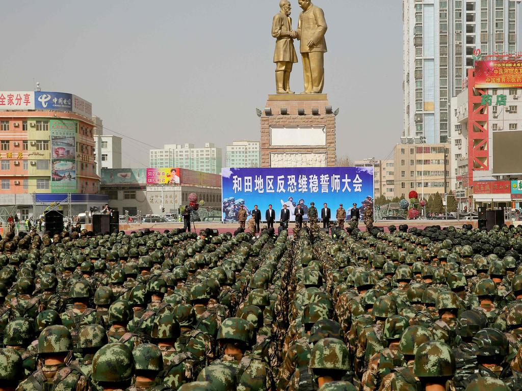 Chinese military police attending an anti-terrorist oath-taking rally in Hotan, in northwest China's Xinjiang Uighur Autonomous Region. Picture: STR / AFP