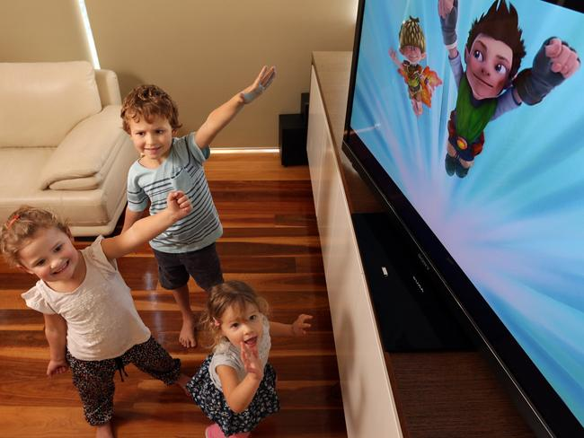 Jack (6), Zara (4) and Allie (2) at home in Northbridge watching and moving along to Tree Fu Tom. Picture: John Fotiadis