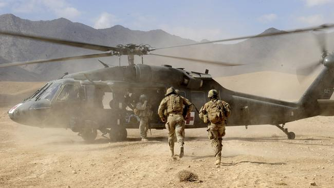 Australian Sergeant Medic Bernadette Serong escorts a casualty to the Aero medical Evacuation (AME) helicopter for transportation back to Tarin Kowt medical facility in Afghanistan. Picture: Channel 7