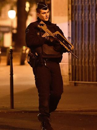 A military police officer patrols on Republique Square.
