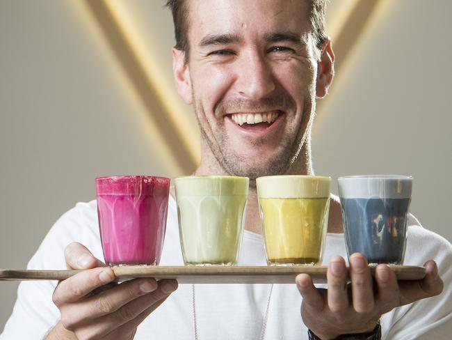Jayben Newson, owner of Too Many Chiefs, shows off the rainbow coffees. Picture: Eugene Hyland