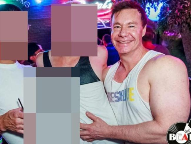 Michael Atkins out with two young men at a nightclub in Brisbane, where he moved to after his acquittal on Matthew's murder.