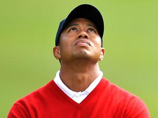 "WIRE: (FILES) US Team member Tiger Woods watches jet airplanes fly overhead during his foursome match on the first day of the Presidents Cup golf competition in this October 8, 2009 file photo at Harding Park Golf course in San Francisco, California. Woods on December 2, 2009 admitted ""transgressions"" saying he had let his family down, in a statement posted on his website that appeared to confirm rumors of an extramarital affair. ""I have let my family down and I regret those transgressions with all of my heart,"" Woods said, appealing for privacy after tabloid reports fueled a media frenzy over his alleged links to women other than his wife, Elin. AFP PHOTO / ROBYN BECK"