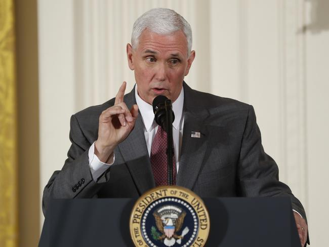 Vice President Mike Pence won't dine with women or even be alone in the same room with a female unless his wife Karen is present. Picture: AP Photo