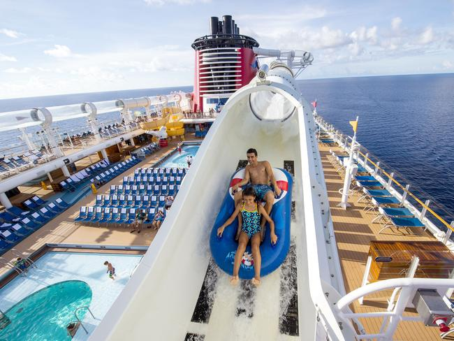 AQUADUCK                    Disney Cruise Line's water coaster AquaDuck gives cruisers the opportunity to get swept away on an exhilarating flume ride above the upper decks of the ship — and even out over the ocean. Spanning four decks in height, the two-person inflatable raft utilises powerful water blasters to propel thrillseekers. Be prepared for the final splashdown at the end.