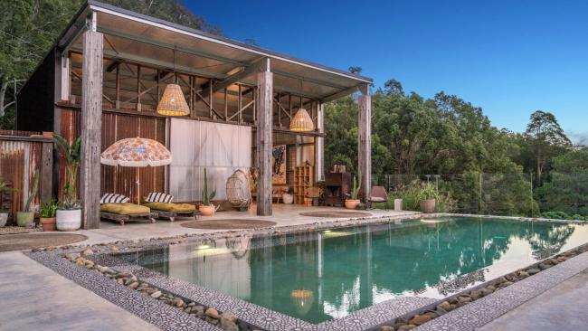 Blackbird Byron Set on a hillside behind Mullum with vistas to Cape Byron lighthouse, this intimate Byron hinterland escape is the ultimate accommodation for couples. The three detached pavilions were designed using reclaimed timber from an old banana shed and have been lifted with contemporary textiles, Moroccan tiles and vintage furniture. There's bubbles and a cheese board on arrival, plus a common area with a magnesium infinity pool and an infrared sauna. Amenities include charcoal toothpaste, handmade soap and locally made teas. blackbirdbyron.com.au