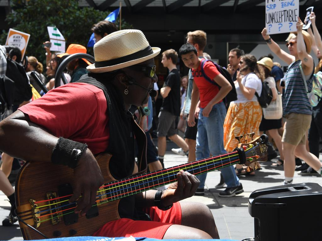 Some of the world's buskers are accepting bitcoin. Picture: James Ross/AAP