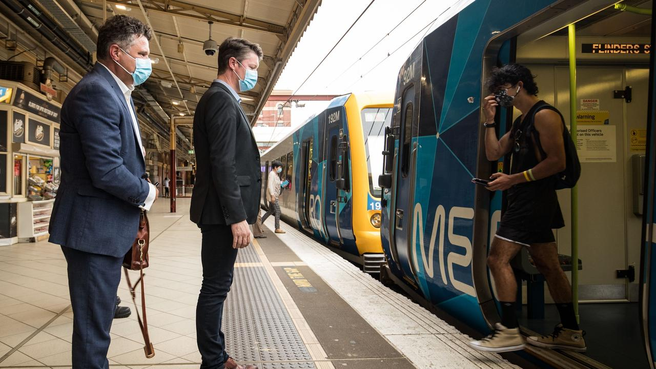 Ben Carroll boards at Flinders Street Station Picture: Darrian Traynor/NCA Newswire