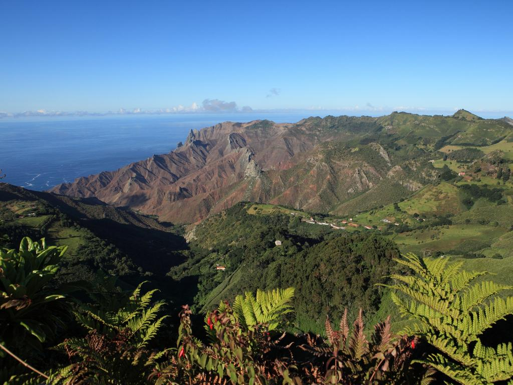 Mountainous district of Sandy Bay on St Helena Island taken from Dianas Peak the highest point on the Island. Good example of the contrast between volcanic coastal terrain and the lush interior and the deep blue South Atlantic Ocean in background. Canon 5D MKII.