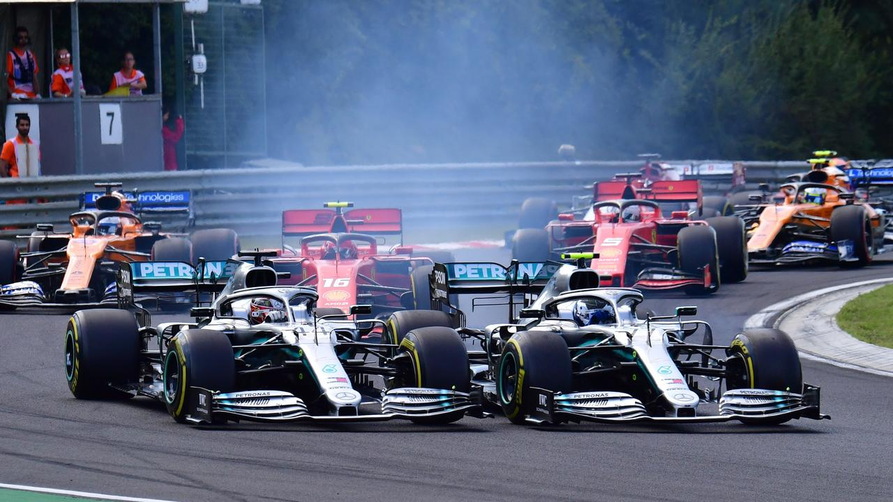 Hamilton (L) and Bottas battle at Turn 2 before it all went wrong for No. 77.
