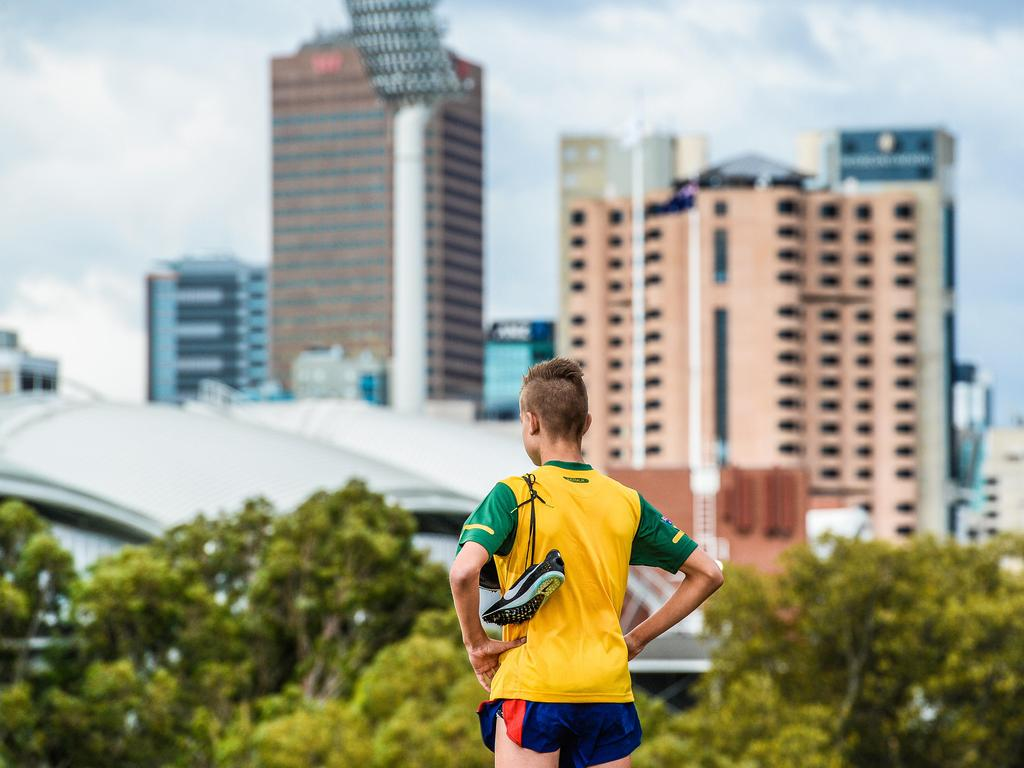 Distance runner Isaac Heyne at Montefiore Hill overlooking Adelaide Oval. Picture: Roy Vandervegt/AAP