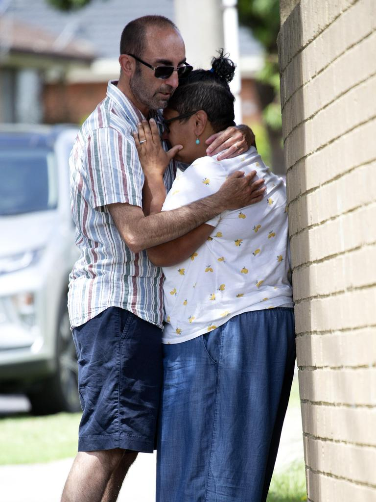 Neighbour Marie Groves is comforted by her partner after she learnt over the phone that it was Perinovic and her children. Picture: NCA NewsWire/Sarah Matray