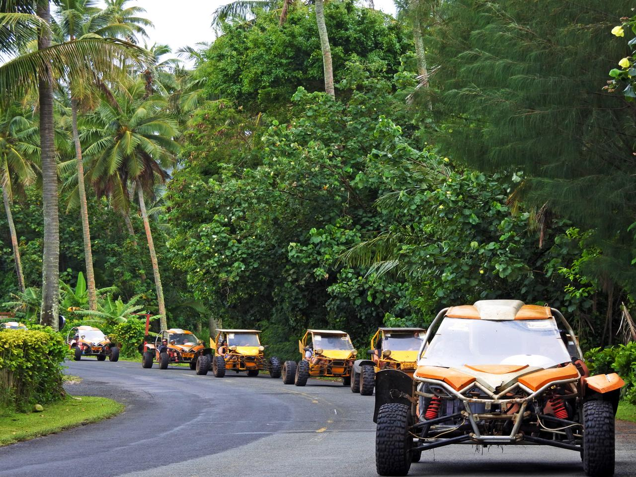 A convoy of Buggy safari adventure tour in Rarotonga, Cook Islands. Beach buggy is a recreational motor vehicle designed for use on sand dunes, beaches and off road terrain.