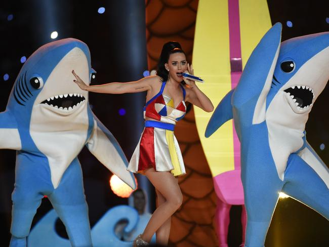 Don't go into the water ... Katy Perry performs alongside the famous sharks. Picture: AFP/Timothy A Clary