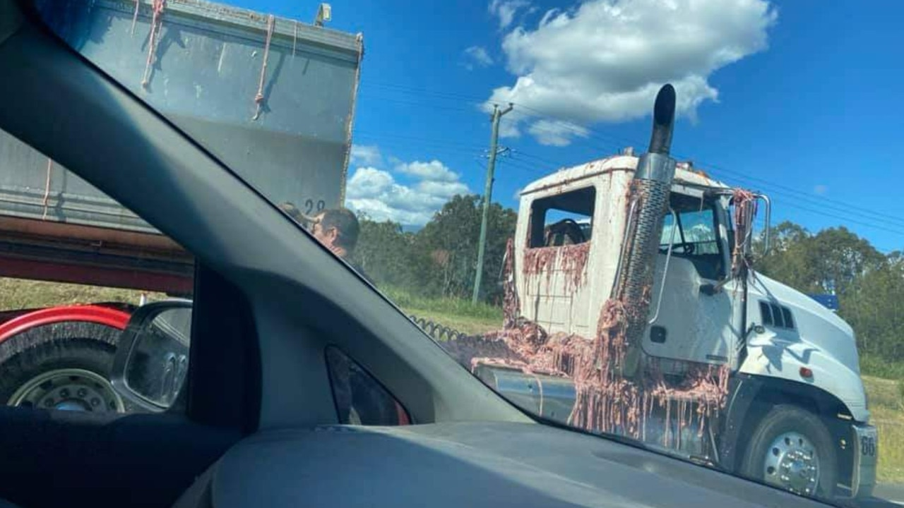 Truck and semi-trailer covered in chicken guts at the intersection of the Mt Lindesay Hwy and Camp Cable Rd at Jimboomba. Picture: Kelly Ratallack