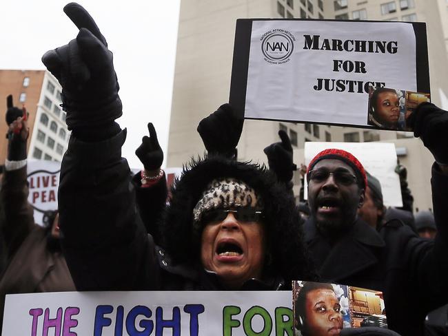 Renla Session chants during a protest in Detroit (AP Photo/Paul Sancya)