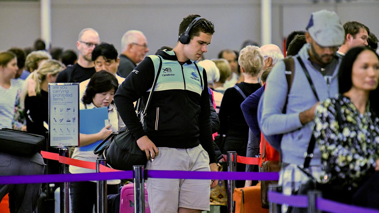 Passengers queue to check in at Sydney Airport on Wednesday. Picture: AAP/Brendan Esposito