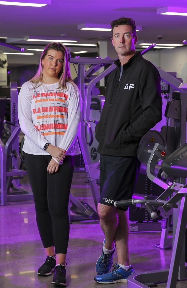 Anytime Fitness owner in Kew, Simon Olive and his daughter Hannah, 19, who is a pilates instructor, pictured last month. Revenue for the gym has dropped to zero since Siman was forced to close his doors. Picture: Wayne Taylor