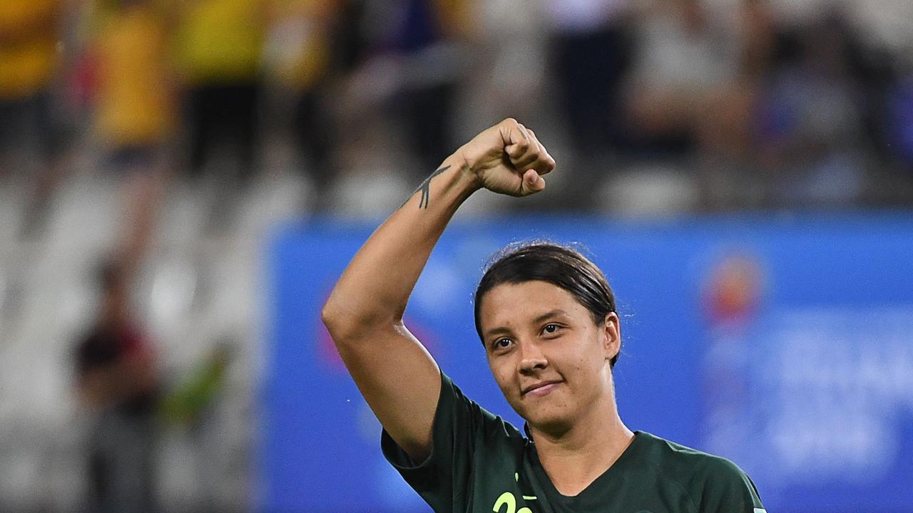Australia's forward Samantha Kerr celebrates after her historic haul
