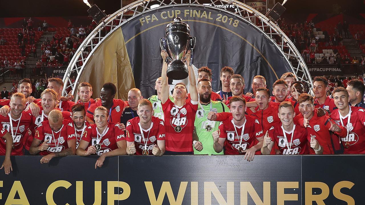 Adelaide United celebrate winning last year's FFA Cup