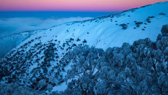 A snowy Mt Hotham at sunrise. Picture: Karl Gray/ Mt Hotham.