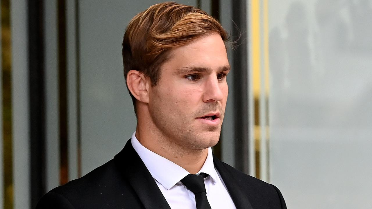 Rugby league player Jack de Belin (right) is seen during a break at the Downing Centre Courts in Sydney.