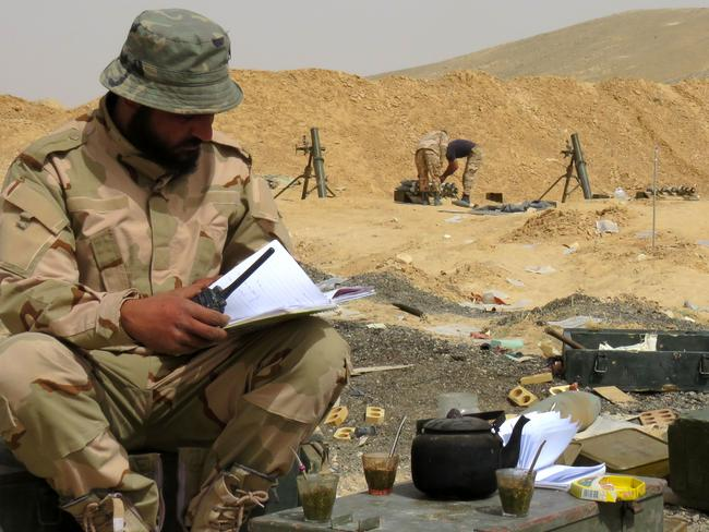 Advance ... The Islamic State group suffered a double setback as army troops recaptured parts of Palmyra and the Pentagon said the jihadists' second-in-command was killed in a US raid. Picture: AFP/STRINGER