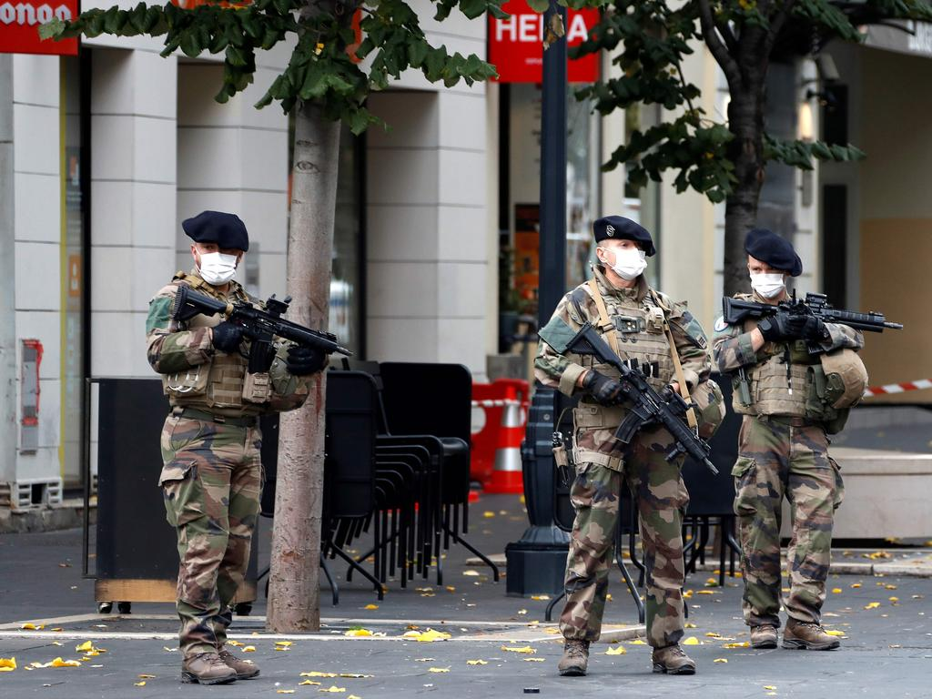French soldiers secure the Basilica of Notre-Dame de Nice after the attack. Picture: Eric Gaillard/AFP
