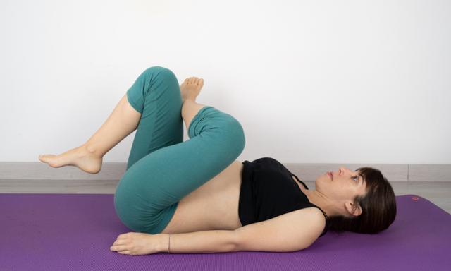 Pregnant woman doing Yoga postures