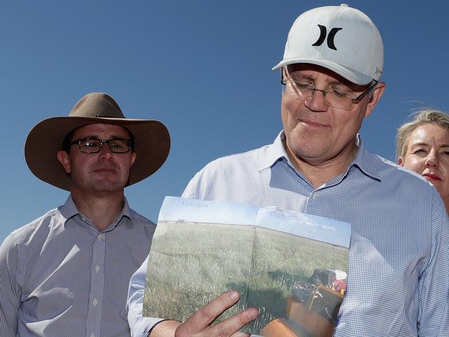 Scott Morrison on a tour of the Queensland bush in his cap, rather than an Akubra. Picture: Alex Ellinghausen