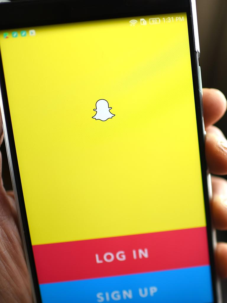 """Court documents revealed the woman predominantly spoke with her victim on Snapchat where she offered to """"suck [his] c*ck"""" and sent a photo of her bare breasts. Picture: Robyn BECK / AFP"""