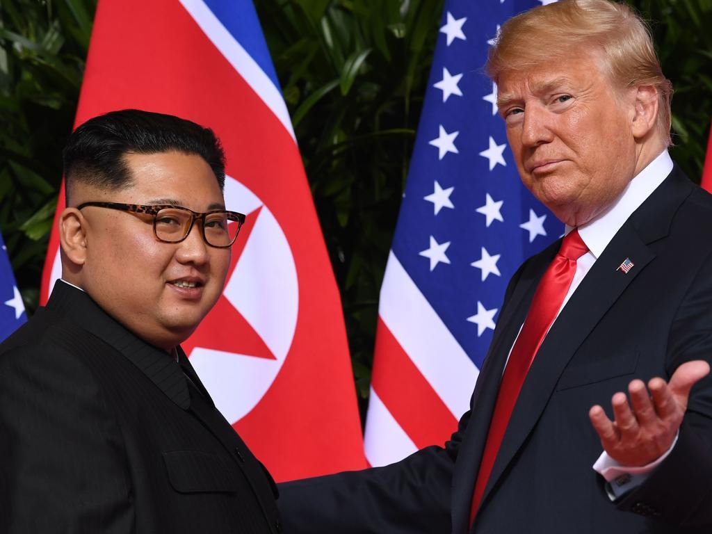 US President Donald Trump (R) meets with North Korea's leader Kim Jong-un. Picture: AFP