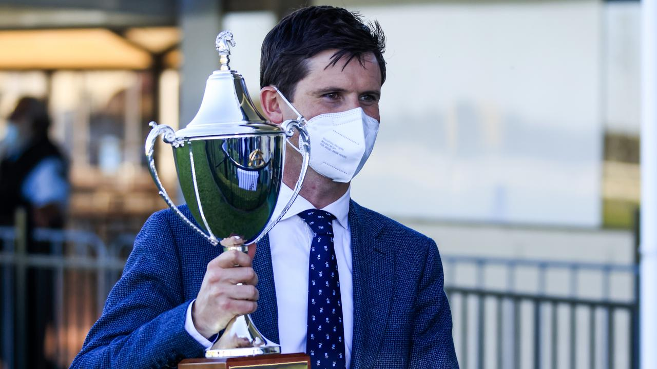 Godolphin trainer James Cummings with the Run To The Rose trophy. Picture: Getty Images