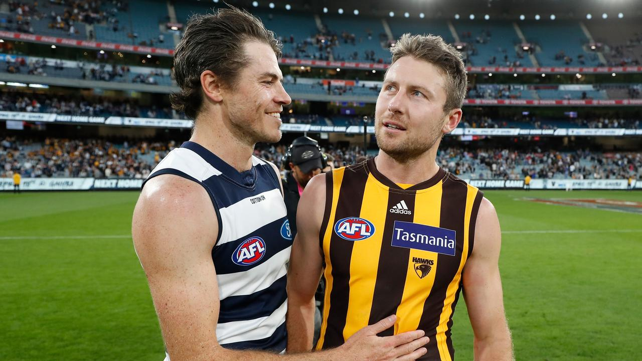 MELBOURNE, AUSTRALIA - APRIL 05: Isaac Smith of the Cats and Luke Breust of the Hawks embrace after the 2021 AFL Round 03 match between the Geelong Cats and the Hawthorn Hawks at the Melbourne Cricket Ground on April 05, 2021 in Melbourne, Australia. (Photo by Michael Willson/AFL Photos via Getty Images)
