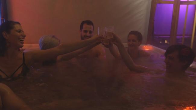 Scantily clad 20-somethings enjoy a glass of bubbly in the hot tub. Picture: New York Post