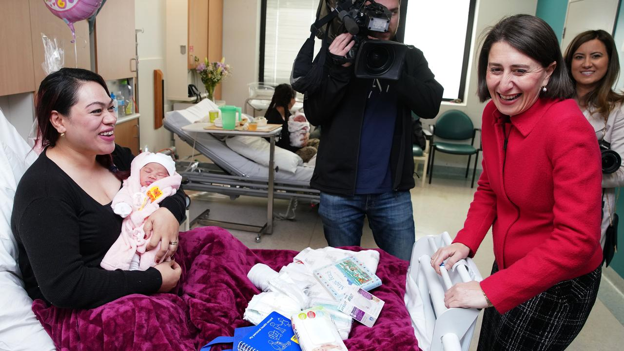 NSW Premier Gladys Berejiklian talks to new mother Ofa Katu and baby Petilisa during a visit to Westmead Hospital on Sunday. Picture: AAP Image/Ben Rushton