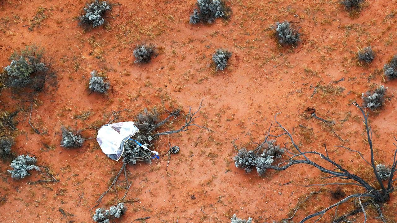The re-entry capsule, carrying samples collected from a distant asteroid, after being dropped off by Japanese space probe Hayabusa-2, following its landing in South Australia. Picture: AFP/JAXA