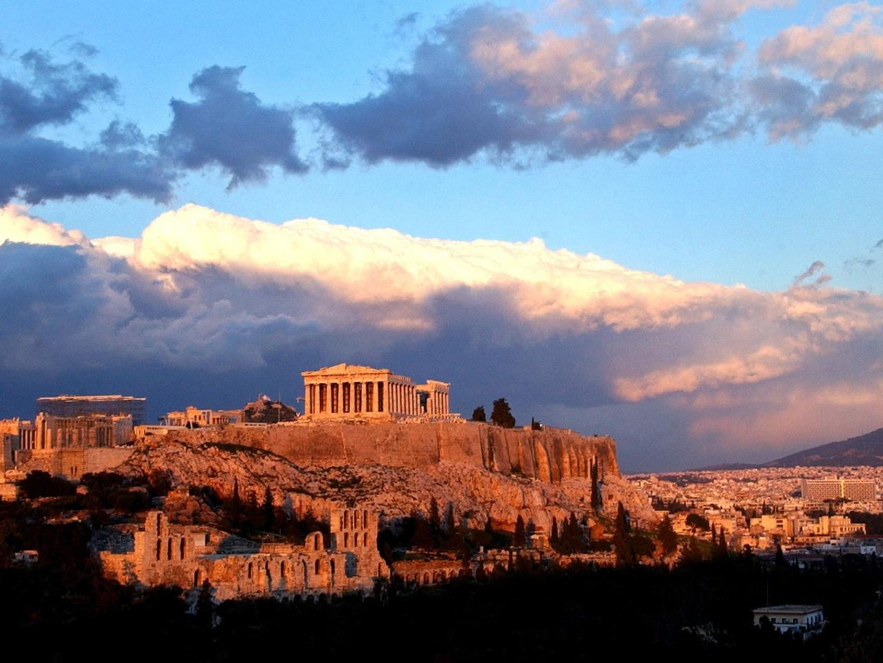 Sunlight catches clouds behind the ancient Acropolis in Athens, Feb 03, 2004. (AP PicPetros/Giannakouris) history o/seas greece scenic travel tourism buildings exterior