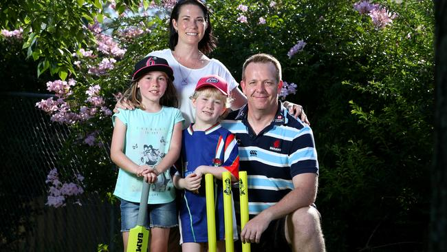 Pictured is the Newbury family, Kirsty and Justin Newbury with their daughters Trinity and Halle. They enjoy playing backyard cricket with friends on a summer evening at their home in Arcadia west of Sydney. Picture: Richard Dobson