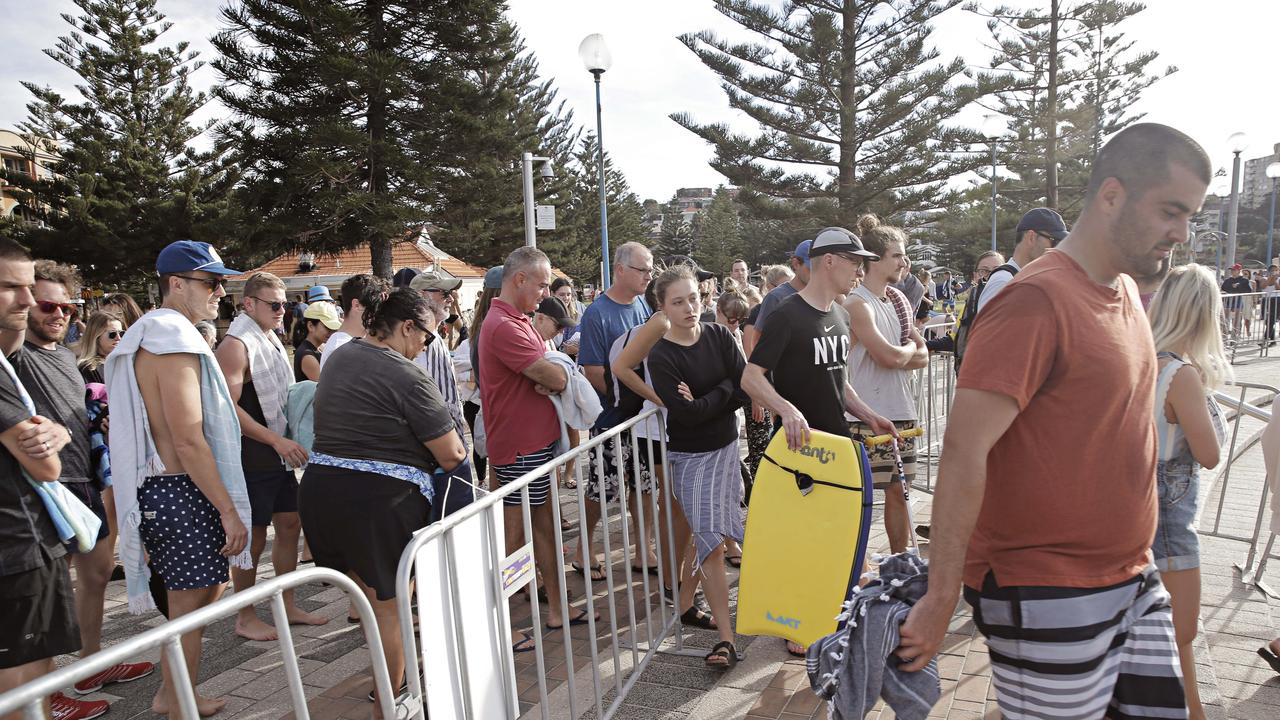 Large crowds squeeze into the entrance of Coogee beach on April 26. Picture: Adam Yip
