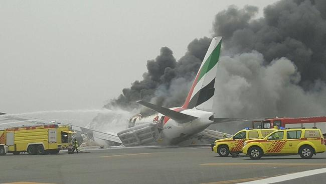 Fourteen people were taken to hospital after the Emirates plane from India crash-landed at Dubai International Airport. A firefighter was killed battling the blaze on the tarmac. Picture: Al Arabiya