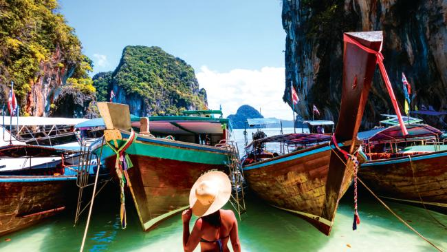 7/11Railay Beach,  Krabi, Thailand If you were told to close your eyes and picture the perfect beach, there's a good chance it would look a lot like Railay. This tranquil spot between the beach towns of Krabi and Ao Nang is the epitome of paradise. Reached by boat, the caramel shores of Railay Beach lie among limestone karsts that emerge like ships on the glassy sea. And with ocean temperatures averaging around 30 degrees, it's cold-water-prude-approved.