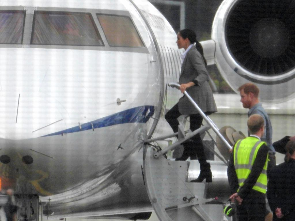 Harry and Meghan leave Sydney for Dubbo on an Air Force jet. They have come under fire for using private jets despite their conservation message. Picture: John Grainger