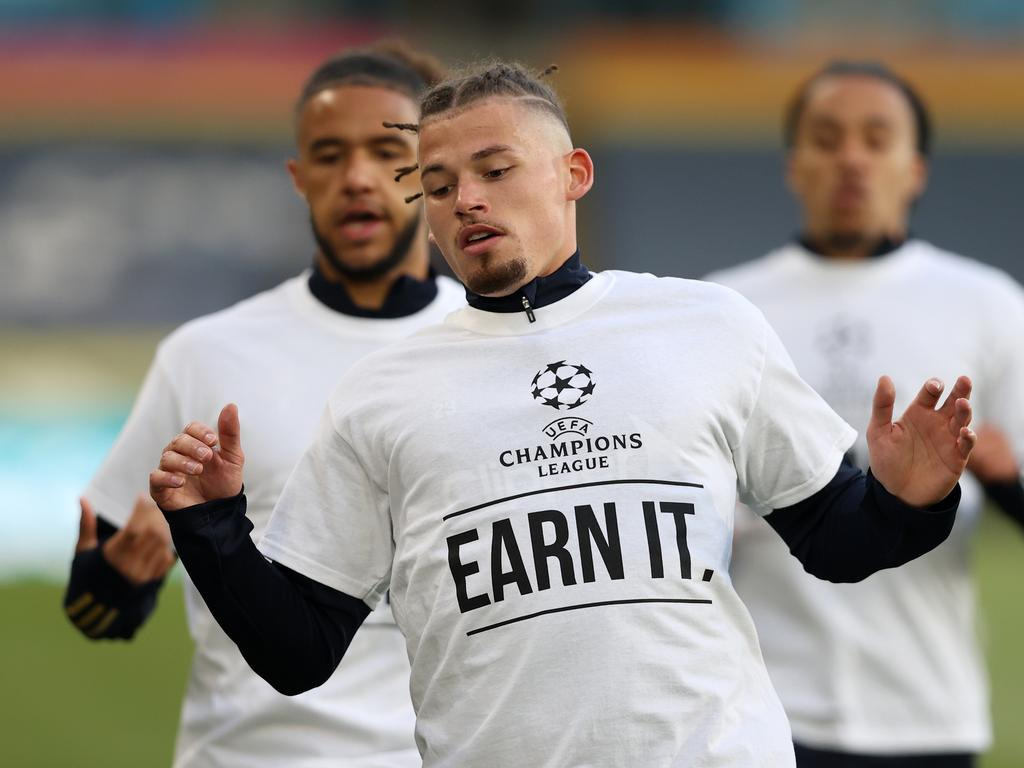 "Kalvin Phillips of Leeds United warms up while wearing a protest T-shirt reading ""Champions League, Earn it"" prior to the Premier League match between Leeds United and Liverpool at Elland Road. (Photo by Clive Brunskill/Getty Images)"