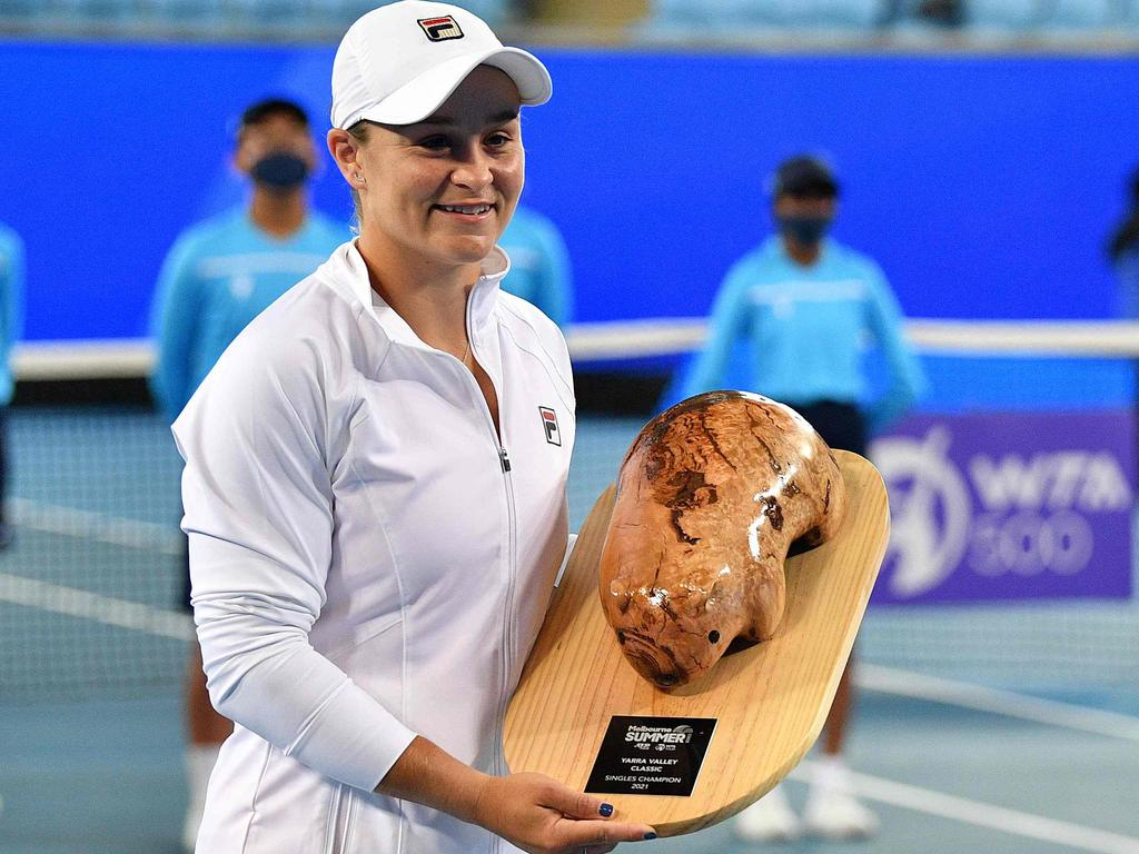 Australia's Ashleigh Barty poses with her trophy after winning the Yarra Valley Classic women's singles final.